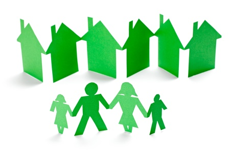 closeup of chain of paper people and houses cut on white background Stock Photo - 13053757