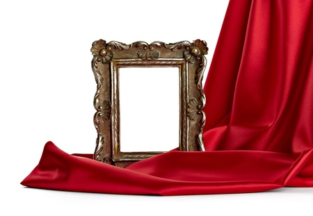 enigma: close up of  a wooden frame coverd with silk on white background
