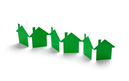 close up of  paper houses on white background photo