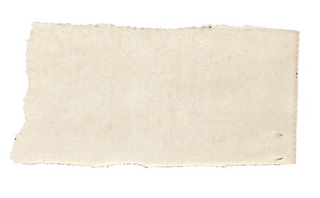 close up of  a white ripped piece of news paper on on white background  photo