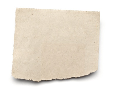 close up of  a white ripped piece of news paper on on white background Stock Photo - 13134917