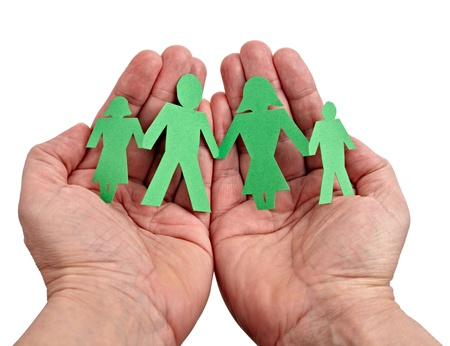 community help: closeup of chain of paper people in hands on white background Stock Photo