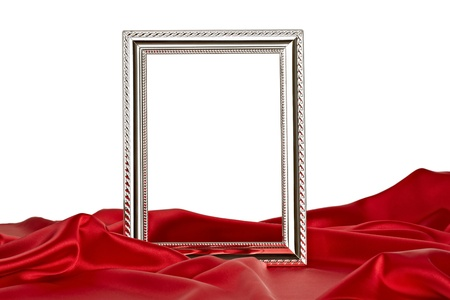 awards ceremony: close up of  a wooden frame coverd with silk on white background
