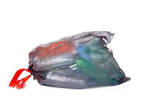 close up of a garbage bag with empty plastic bottles  photo