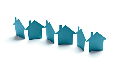 close up of paper houses on white background Stock Photo
