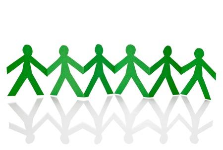 apoyo familiar: Primer plano de la cadena de personas de papel cortado en el fondo blanco Foto de archivo