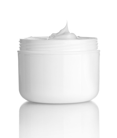 body milk: close up of  beauty cream container on white background