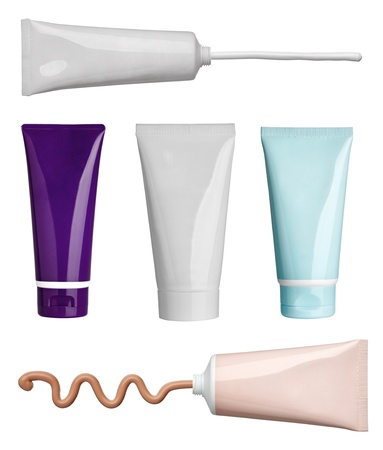 tube: collection of various beauty cream and powder strokes and tubes on white background. each one is shot separately