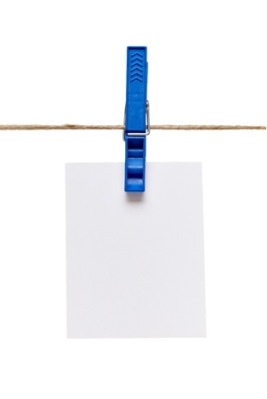 pegs: close up of  a note and a clothes peg on white background  Stock Photo