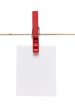 clothes peg: close up of  a note and a clothes peg on white background  Stock Photo