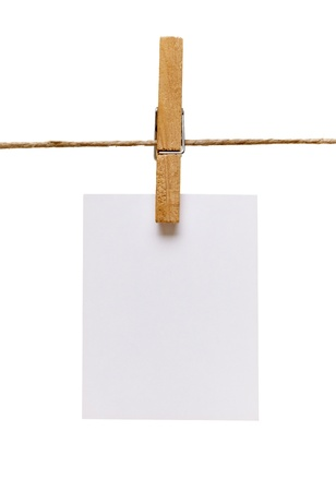clothes pins: close up of  a note and a clothes peg on white background  Stock Photo