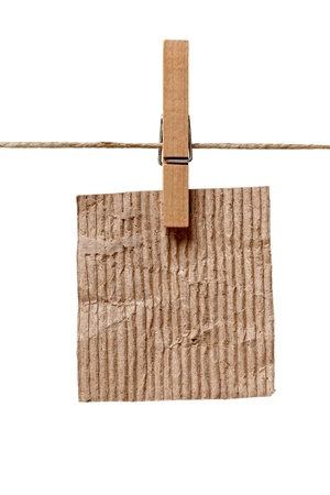 close up of  a note and a clothes peg on white background  photo
