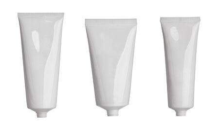 collection of  various beauty hygiene tubes on white background. each one is shot separately photo