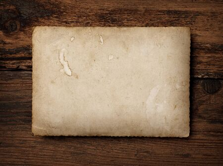 close up of an old photo on a wooden background photo