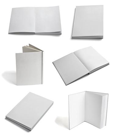 libros abiertos: colecci�n de varios de papel en blanco sobre un fondo blanco cada uno de ellos recibe un disparo por separado