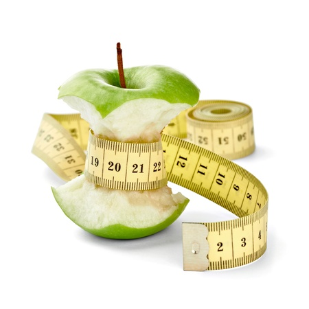 lose weight: close up of  an apple measuring tape on white background  Stock Photo