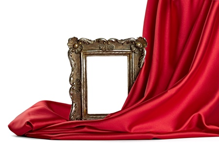 drape: close up of  a wooden frame coverd with silk on white background