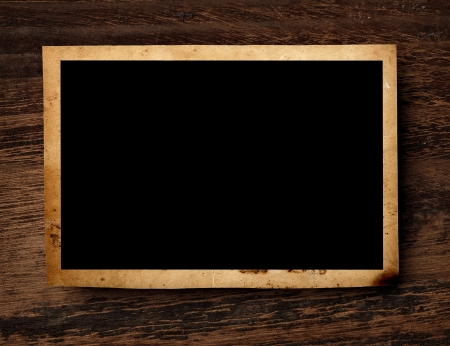 old photograph: close up of an old photo on a wooden background