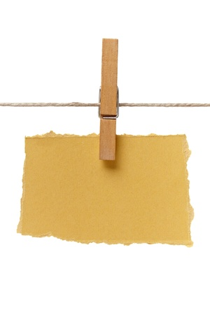 close up of  a note and a clothes peg on white background with clipping path photo
