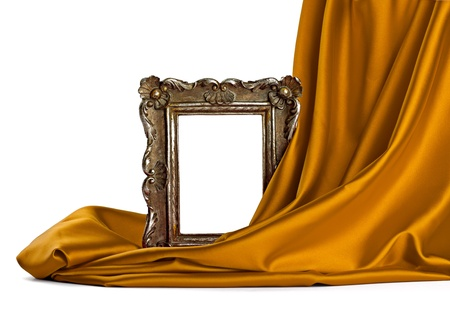 covered: close up of  a wooden frame coverd with silk on white background
