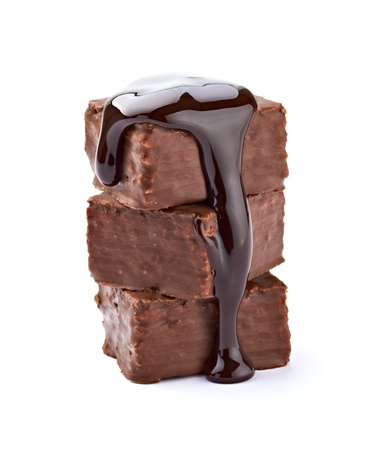 close up of a chocolate syrup on a cake on white background  photo