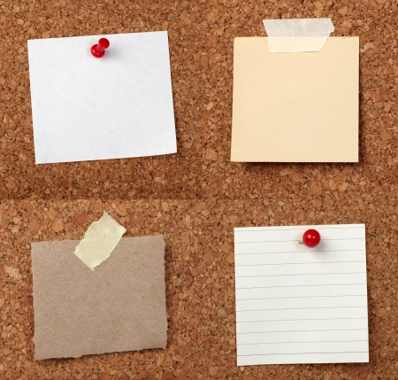 drawing pins: collection of various note papers  on cork board