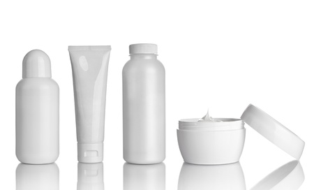 toiletries: collection of  various beauty hygiene containers on white background. each one is shot separately