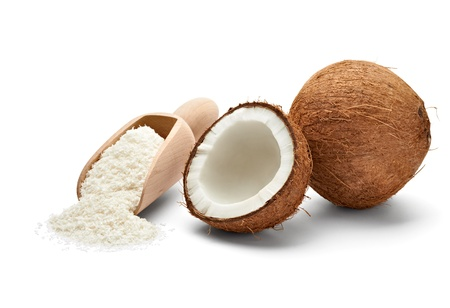 coco: close up of a coconut and grounded coconut flakes Stock Photo