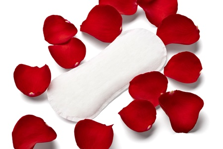 tampon: close up of woman hygiene protection and rose petals on white background