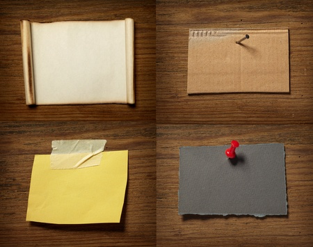 collection of various grunge note papers on wooden background photo