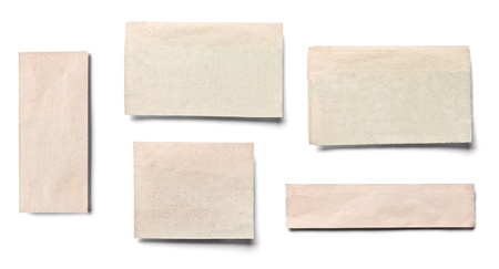 collection of  white ripped pieces of news paper on on white background  each one is shot separately photo