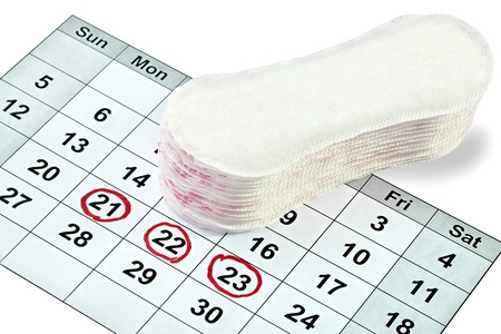 pms: close up of woman hygiene protection on a calendar