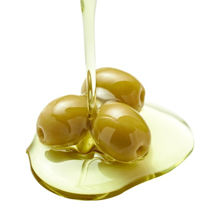 plant oil: close up of olive oil on white background