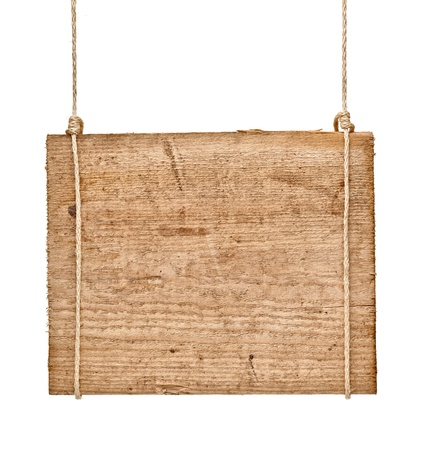 wooden plaque: close up of an empty wooden sign hanging on a rope on white background