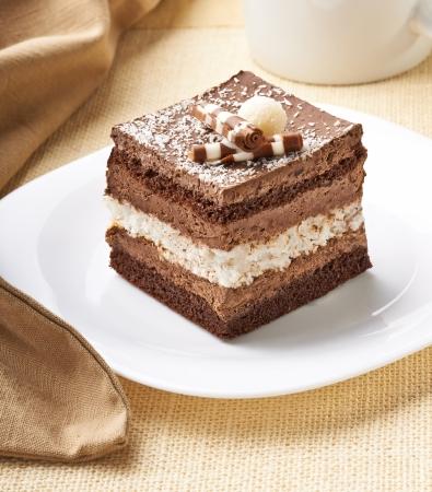 chocolate slice: close up of a cream cake on white plate Stock Photo