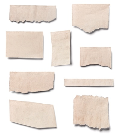 collection of  white ripped pieces of news paper on on white background. each one is shot separately photo