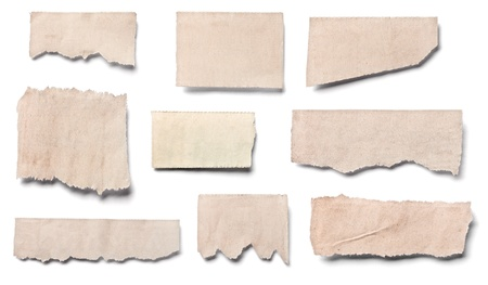 blank newspaper: collection of  white ripped pieces of news paper on on white background. each one is shot separately Stock Photo