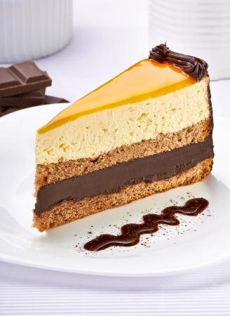 chocolate mousse: close up of a cream cake on white plate Stock Photo