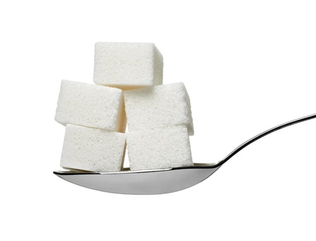 sugar cube: close up of  sugar cubes in a spoon on white background with clipping path Stock Photo