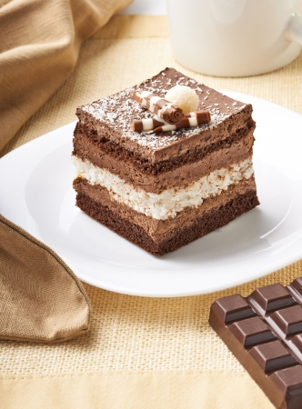 chocolate syrup: close up of a cream cake on white plate Stock Photo