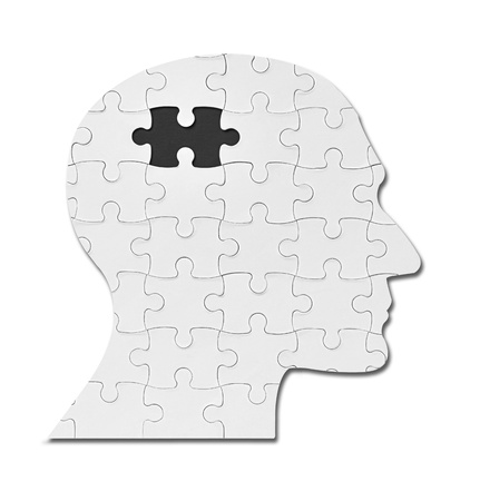 brain puzzle: close up of a puzzle game parts on a head silhouette Stock Photo