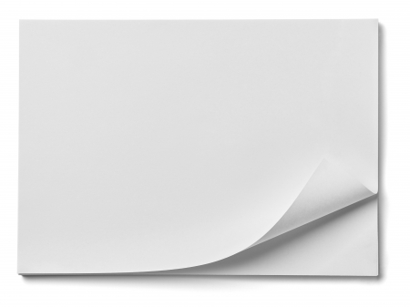 paper curl: close up of stack of papers with curl on white background