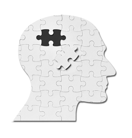 health answers: close up of a puzzle game parts on a head silhouette Stock Photo