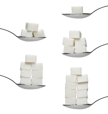 sugar: sugar cubes in aspoon