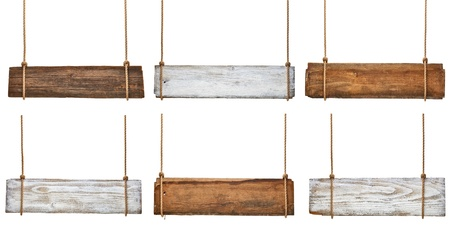 collection of various empty wooden signs hanging on a rope on white background each one is shot separately