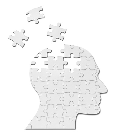 head toy: close up of a puzzle game parts on a head silhouette Stock Photo