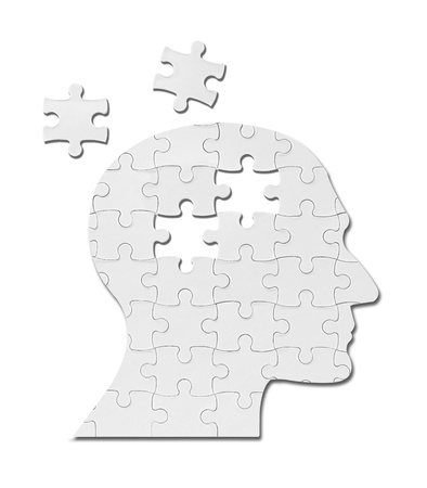 close up of a puzzle game parts on a head silhouette Stock Photo