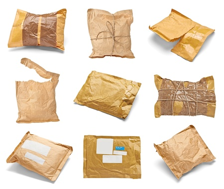 parcels: collection of various used open mail package on white background  each one is shot separately Stock Photo