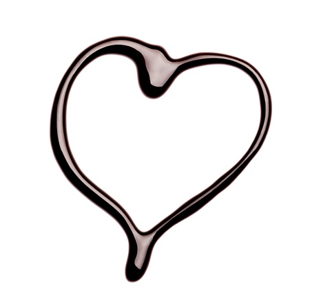 chocolate drop: close up of  a chocolate heart on white background