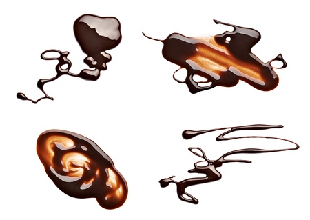 melted chocolate: collection of  various chocolate stains on white background